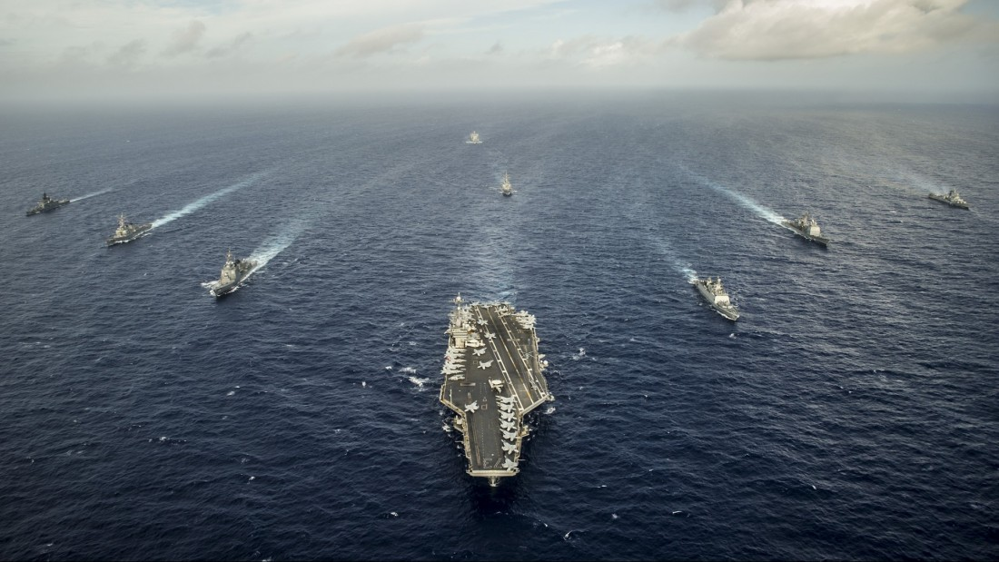 The aircraft carrier USS George Washington (CVN 73) and ships from the U.S. Navy, the Indian navy, and the Japan Maritime Self-Defense Force participate in a photo exercise during Malabar 2014. Malabar is a U.S. Navy, Indian Navy, Japan Maritime Self-Defense Force trilateral naval field training exercise aimed to improve our collective maritime relationship and increase understanding in multinational operations. (U.S. Navy photo by Mass Communication Specialist 3rd Class Chris Cavagnaro/Released)