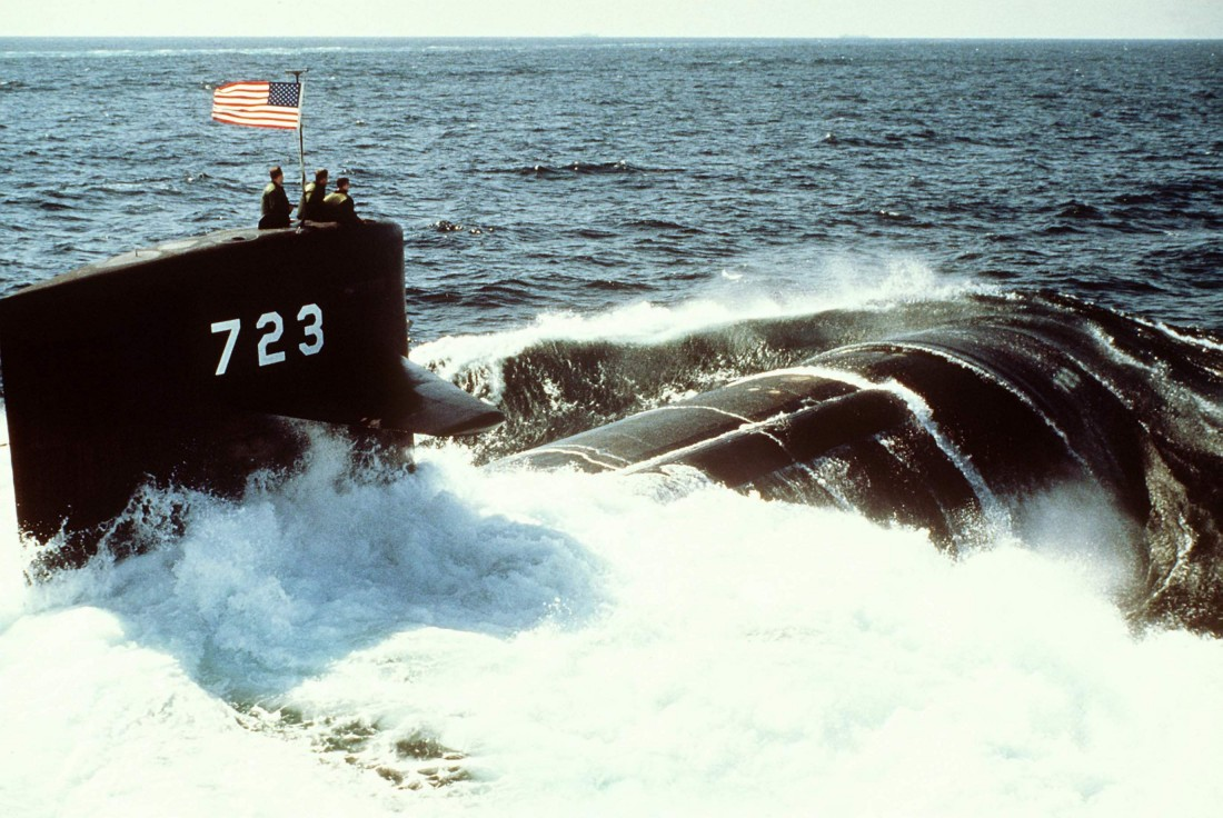 A starboard quarter view of the nuclear-powered attack submarine Oklahoma City (SSN-723) underway on 26 February 1988. Official USN photo # DN-ST-89-01401 by Chris Oxley, courtesy of dodmedia.osd.mil.