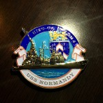 The ceremonial coin of the USS Normandy